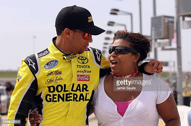 Darrell Wallace Jr driver of the Dollar General Toyota hugs mom Desi Wallace prior to qualifying for the Pioneer HiBred 250 on May 19 2012 at Iowa...