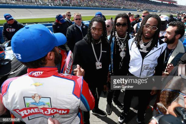 Darrell Wallace Jr driver of the Farmer John Chevrolet meets Migos on the grid prior to the Monster Energy NASCAR Cup Series Auto Club 400 at Auto...