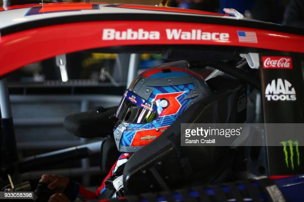 Darrell Wallace Jr driver of the Farmer John Chevrolet sits in his car during practice for the Monster Energy NASCAR Cup Series Auto Club 400 at Auto...