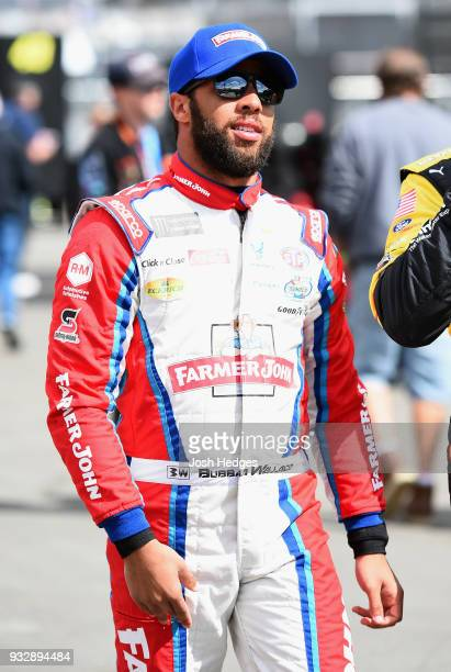 Darrell Wallace Jr driver of the Farmer John Chevrolet walks in the garage area during practice for the Monster Energy NASCAR Cup Series Auto Club...