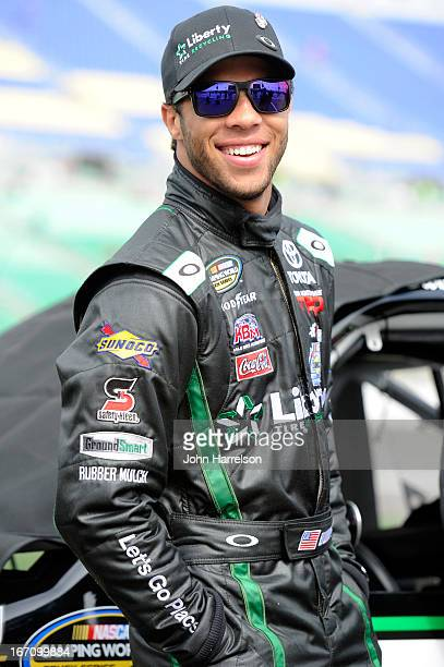 Darrell Wallace Jr driver of the LibertyTireRecycling/Ground SmartRubber Toyota walks in the grid during qualifying for the NASCAR Camping World...