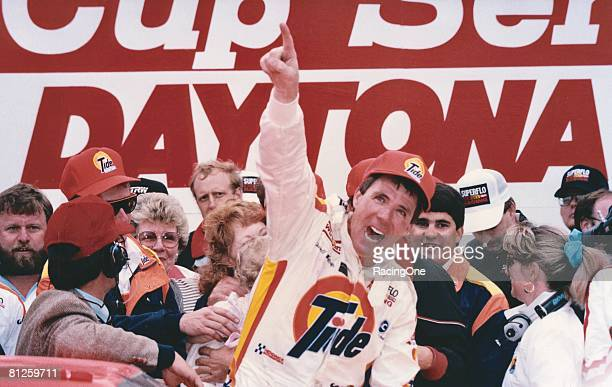 Darrell Waltrip driver of the Tide Chevrolet celebrates in victory lane after winning the Winston Cup Daytona 500 at the Daytona International...