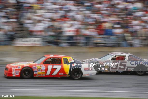 Darrell Waltrip drives his Tide car against the Phil Parsons Crown car during the Daytona 500 at the Daytona Speedway on February 19 1989 at Daytona...