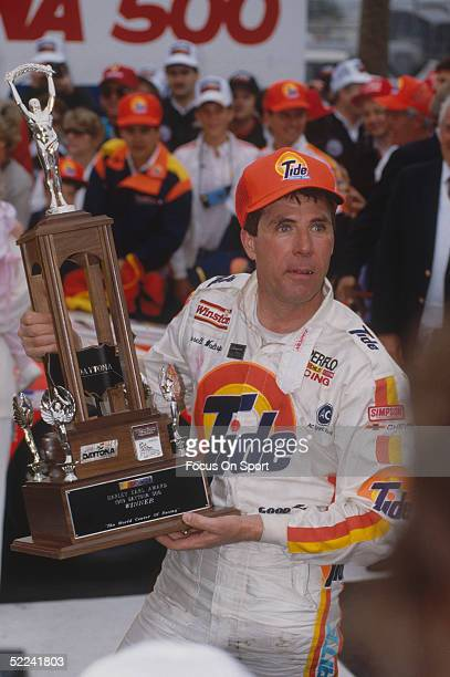 Darrell Waltrip holds his trophy after winning the Daytona 500 at the Daytona Speedway on February 19 1989 at Daytona Beach Florida