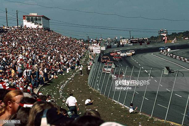 Darrell Waltrip leads the field during the running of the Holly Farms 400 NASCAR Cup race at North Wilkesboro Speedway Waltrip dominated Cup action...