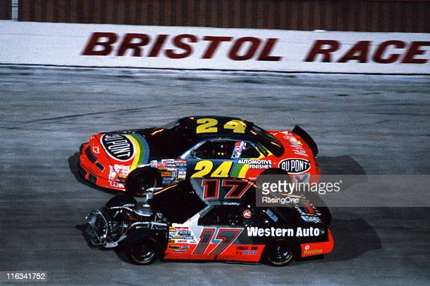 Darrell Waltrip races with Jeff Gordon in the Bud 500 NASCAR Cup race at Bristol International Raceway despite the removal of all of the front sheet...