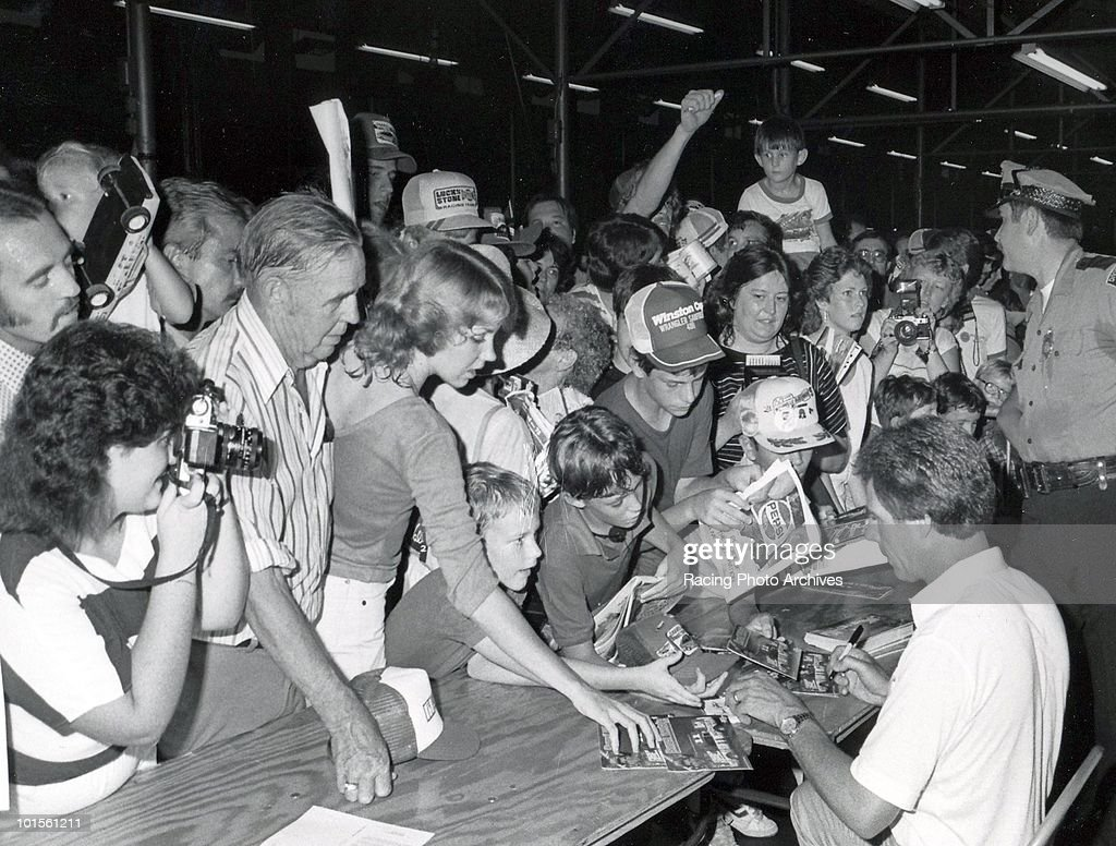 Darrell Waltrip signs autogrpahs for his fans before racing in the Delaware 500. Waltrip would finish in 2nd place and take home $29,750 for the race.