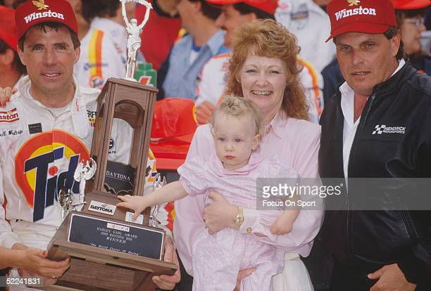 Darrell Waltrip stands next to his wife and daughter holding a trophy after winning the Daytona 500 at the Daytona Speedway on February 19 1989 at...