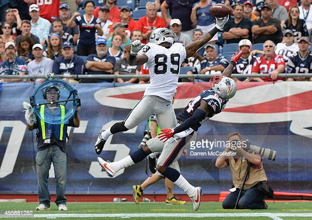 Darrelle Revis of the New England Patriots breaks up a pass intended for James Jones of the Oakland Raiders in the fourth quarter at Gillette Stadium...