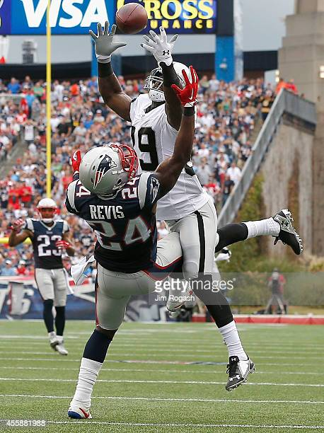 Darrelle Revis of the New England Patriots breaks up a pass intended for James Jones of the Oakland Raiders during the fourth quarter at Gillette...