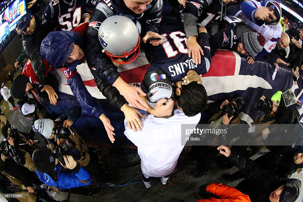 Darrelle Revis #24 of the New England Patriots celebrates with fans after defeating the Indianapolis Colts in the 2015 AFC Championship Game at Gillette Stadium on January 18, 2015 in Foxboro, Massachusetts. The Patriots defeated the Colts 45-7.