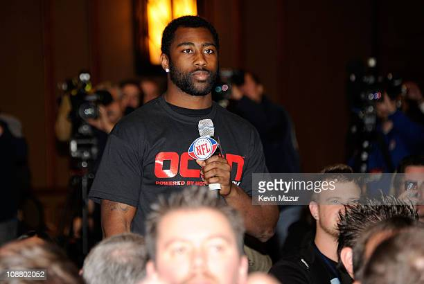 Darrelle Revis of the New York Jets asks will.i.am of the Black Eyed Peas a question at the Bridgestone Super Bowl XLV Halftime Show press conference...