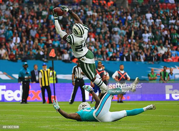 Darrelle Revis of the New York Jets intercepts a pass intended for Jarvis Landry of the Miami Dolphins during the game at Wembley Stadium on October...