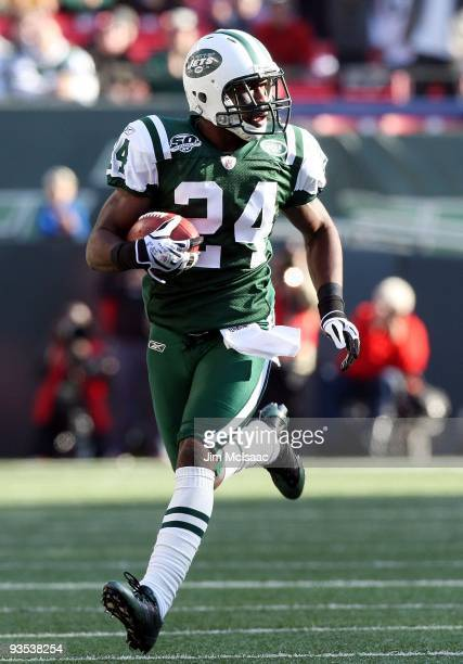 Darrelle Revis of the New York Jets runs the ball in for a first quarter touchdown after an interception against the Carolina Panthers on November...