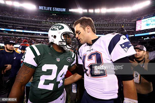 Darrelle Revis of the New York Jets talks with Tom Brady of the New England Patriots after their game at MetLife Stadium on November 27 2016 in East...