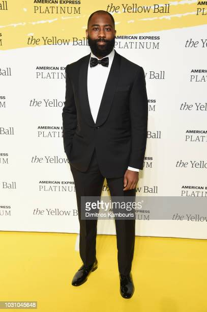 Darrelle Revis poses on the Yellow carpet at the Yellow Ball, hosted by American Express and Pharrell Williams, at the Brooklyn Museum on September...