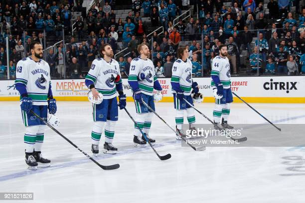 Darren Achibald Brandon Sutter Alexander Edler Loui Eriksson and Erik Gudbranson of the Vancouver Canucks line up for the national anthem of the game...