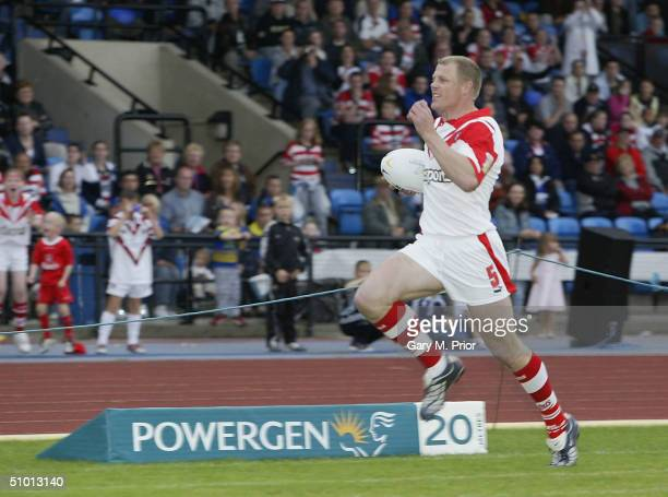 Darren Albert of St Helens wins the Powergen Fastest Man in Rugby League competition at the Robin Park Arena on June 30 2004 in Wigan England