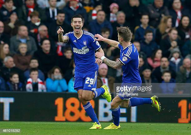 Darren Ambrose of Ipswich celebrates with teammate Luke Hyam of Ipswich after scoring the opening goal during the FA Cup Third Round match between...