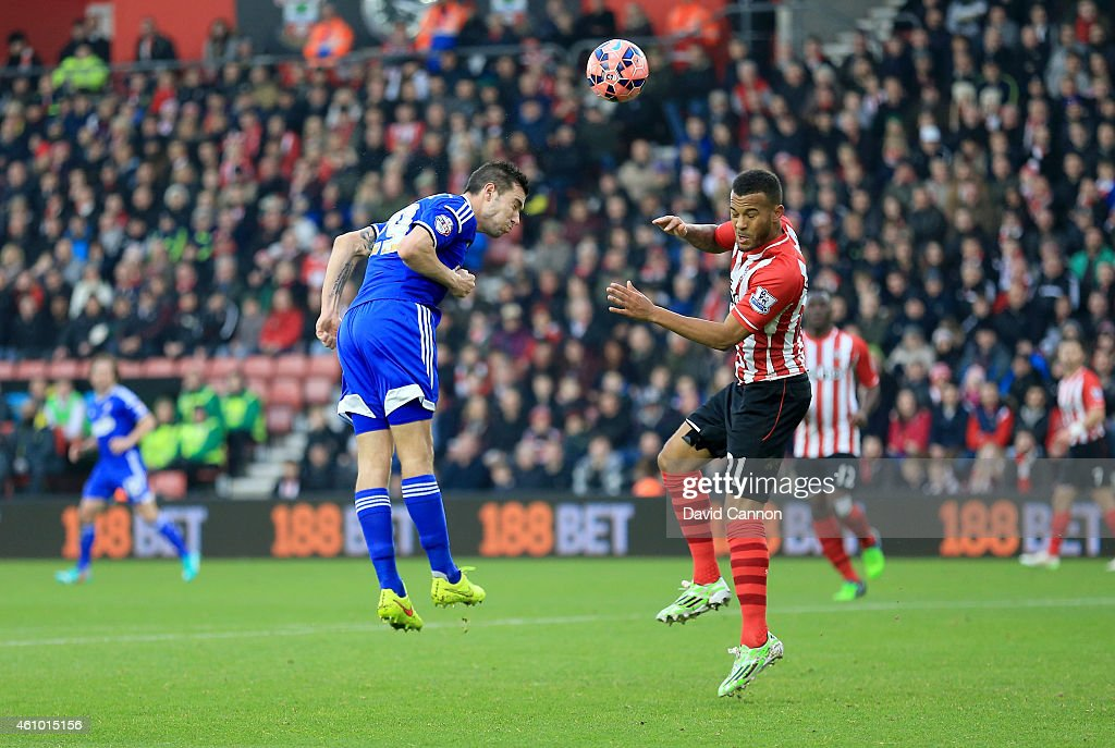 Darren Ambrose of Ipswich Town beats Ryan Bertrand of Southampton in the air to score Ipswich's first goal during the FA Cup Third Round match between Southampton and Ipswich Town at St Mary's Stadium on January 4, 2015 in Southampton, England.