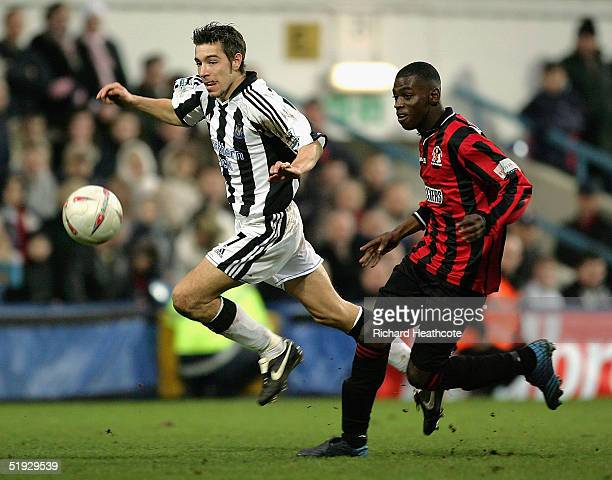 Darren Ambrose of Newcastle battles for the ball with Bradley Quamina of Yeading during the FA Cup Third Round match between Yeading and Newcastle...