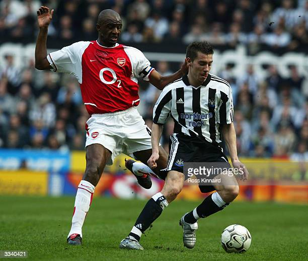 Darren Ambrose of Newcastle holds off Patrick Vieira of Arsenal during the FA Barclaycard Premiership match between Newcastle United and Arsenal at...