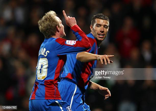 Darren Ambrose of Palace celebrates with the second goal scorer Jonathan Williams of Palace during the Carling Cup second round match between Crystal...