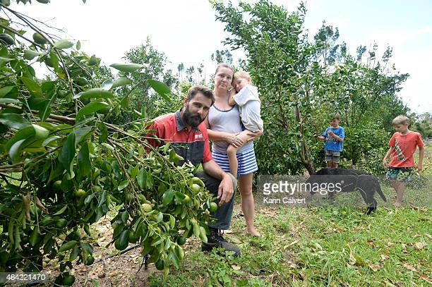 Darren and Heidi Lucht with three of their five children, Lincoln Mason and Michael on February 23, 2015 in Byfield, Australia. The citrus farmers...