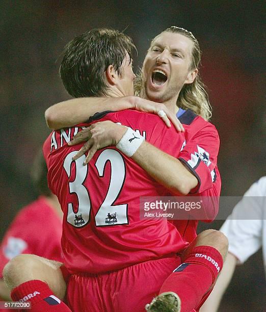 Darren Anderton of Birmingham City celebrates scoring their first goal with Robbie Savage during the Barclays Premiership match between Blackburn...