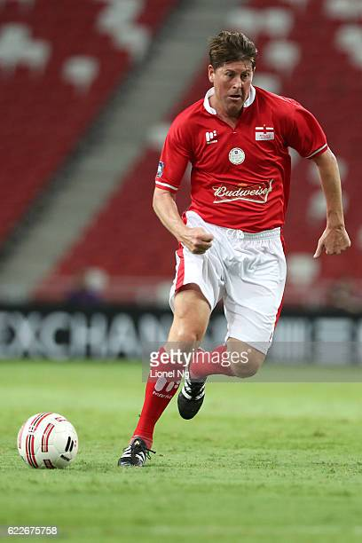 Darren Anderton of England Masters dribbles the ball during the match between Germany Masters and England Masters at National Stadium on November 12...
