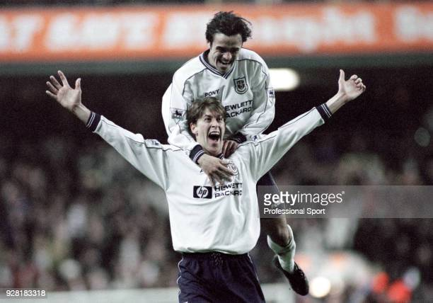 Darren Anderton of Tottenham Hotspur celebrates with teammate Stephen Carr after scoring during the FA Cup 5th Round Replay between Tottenham Hotspur...