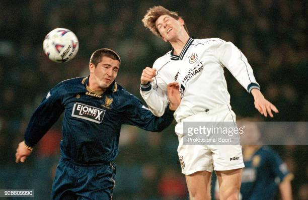 Darren Anderton of Tottenham Hotspur heads the ball in front of Andy Roberts of Wimbledon during an FA Cup 4th Round tie at Selhurst Park on January...