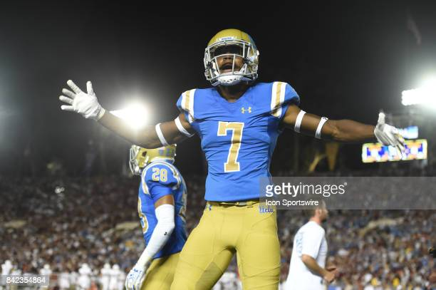 Darren Andrews gets the crowd fired up late in the fourth quarter during a college football game between the Texas AM Aggies and the UCLA Bruins on...
