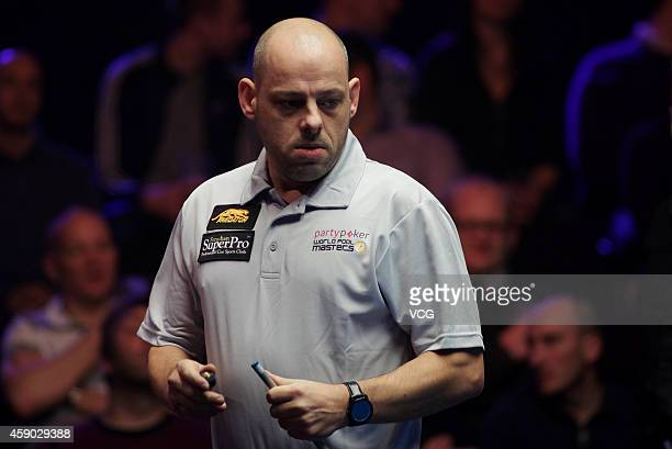 Darren Appleton of Great Britain chalks his cue against Alex Pagulayan of Canada on day one of the Partypoker World Pool Masters 2014 at Portland...