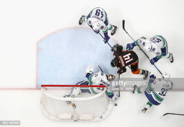 Darren Archibald Henrik Sedin Jacob Markstrom and Alex Biega of the Vancouver Canucks defend against Adam Henrique of the Anaheim Ducks during the...
