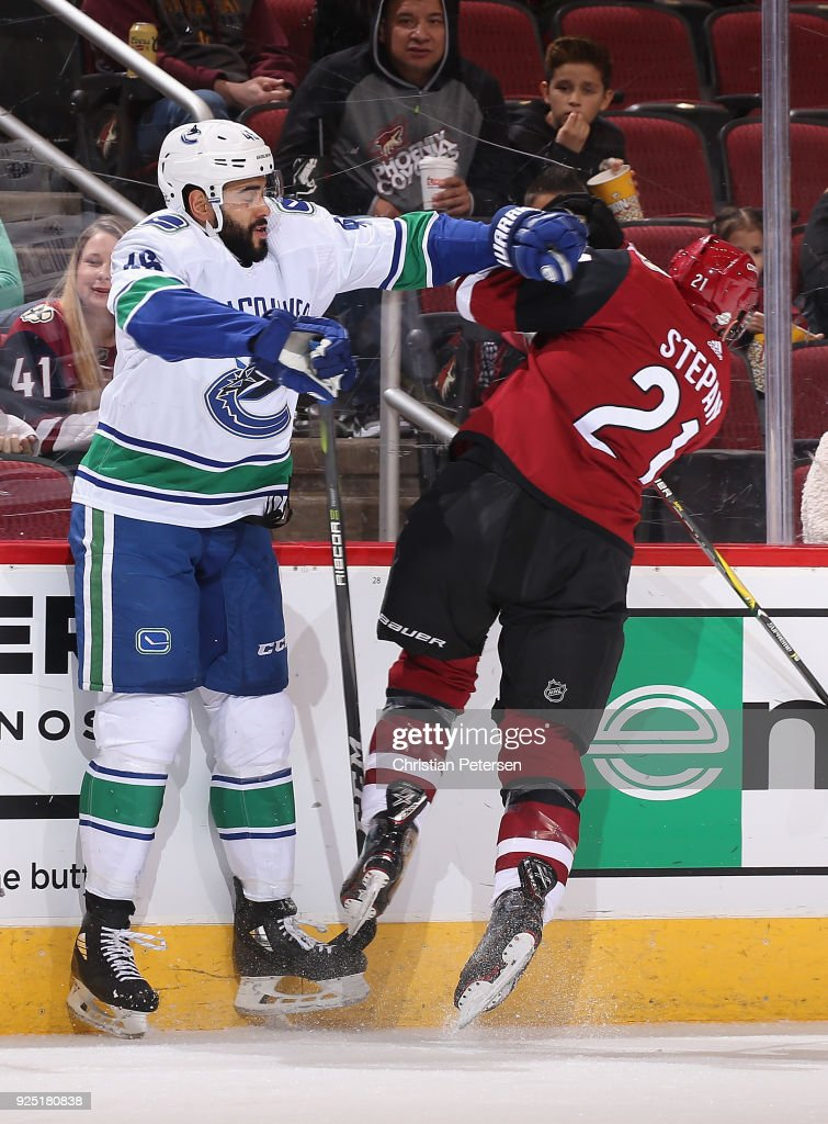 Darren Archibald #49 of the Vancouver Canucks body checks Derek Stepan #21 of the Arizona Coyotes during the first period of the NHL game at Gila River Arena on February 25, 2018 in Glendale, Arizona. The Canucks defeated the Coyotes 3-1