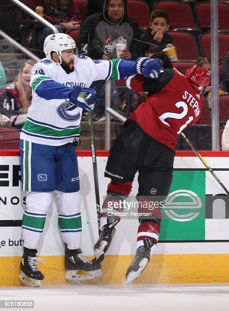 Darren Archibald of the Vancouver Canucks body checks Derek Stepan of the Arizona Coyotes during the first period of the NHL game at Gila River Arena...