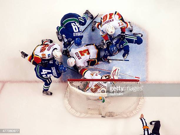 Darren Archibald of the Vancouver Canucks scores a goal against goalie Joni Ortio of the Calgary Flames during the second period in NHL action on...