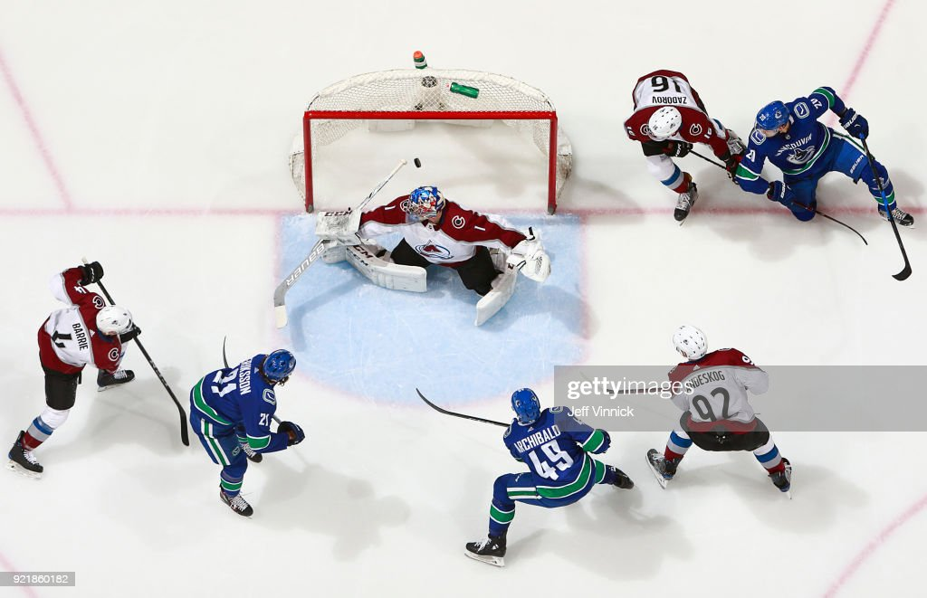 Darren Archibald #49 of the Vancouver Canucks scores on Semyon Varlamov #1 of the Colorado Avalanche during their NHL game at Rogers Arena February 20, 2018 in Vancouver, British Columbia, Canada. Colorado won 5-4.