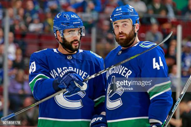 Darren Archibald of the Vancouver Canucks talks with teammate Erik Gudbranson during their NHL game against the Colorado Avalanche at Rogers Arena...