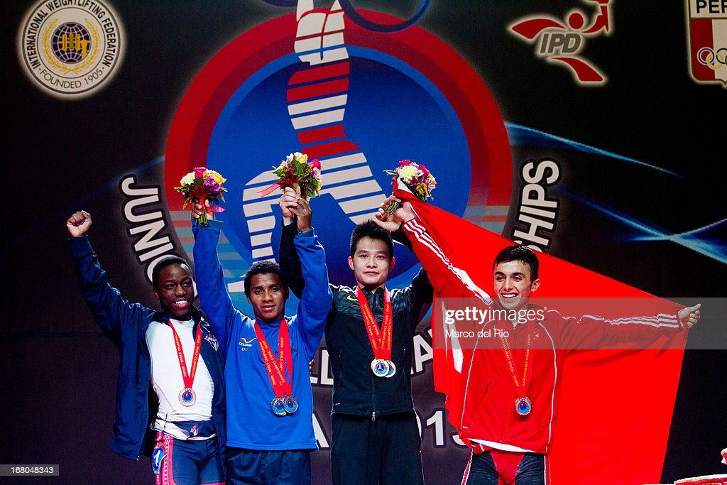 Darren Barnes of US (L), Colombian Mendoza (2L-R), Xiameng Wei of China (3L-R) and Muammer Sahin (R) during podium of the Men's 56kg during day one of the 2013 Junior Weightlifting World Championship at Maria Angola Convention Center on April 04, 2013 in Lima, Peru.