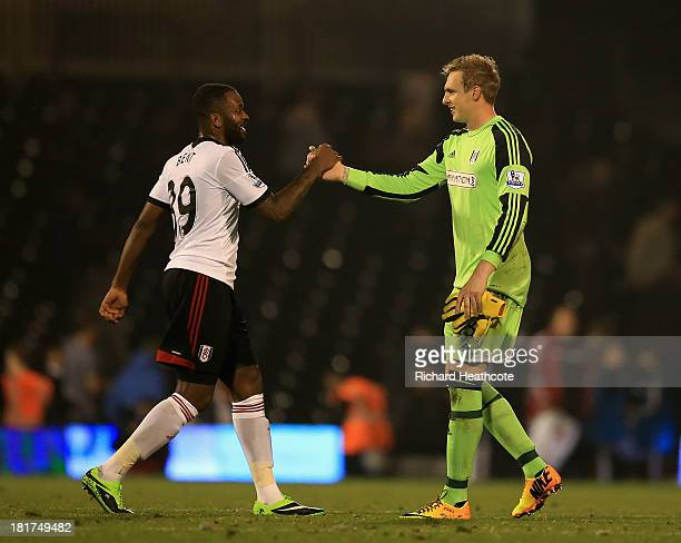 Darren Bent and David Stockdale of Fulham celebrate at the final whistle during the Captial One Cup Third Round match between Fulham and Everton at...