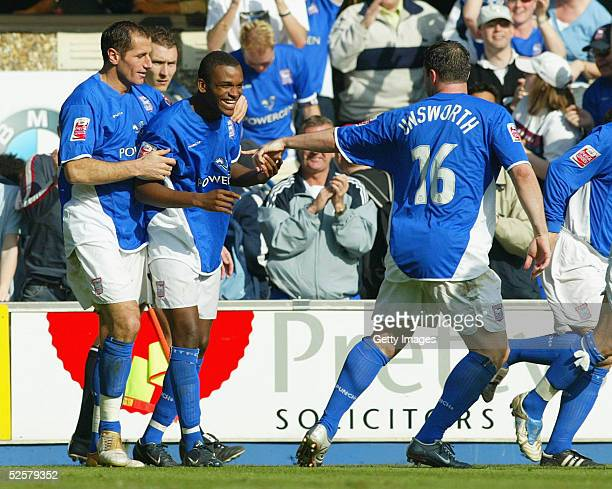 Darren Bent celebrates with ShefkiKuqi and David Unsworth during the Coca Cola Championship League match between Ipswich Town and Derby County at...
