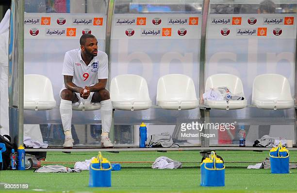 Darren Bent looks on from the bench after being substituted during the International Friendly match between Brazil and England at the Khalifa Stadium...