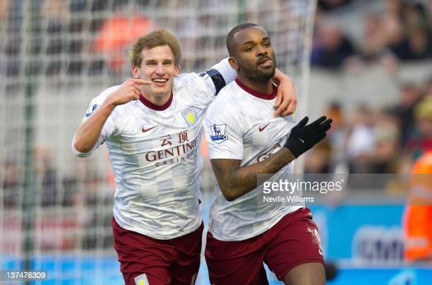 Darren Bent of Aston Villa celebrates his goal with team mate Marc Albrighton during the Barclays Premier League match between Wolverhampton...