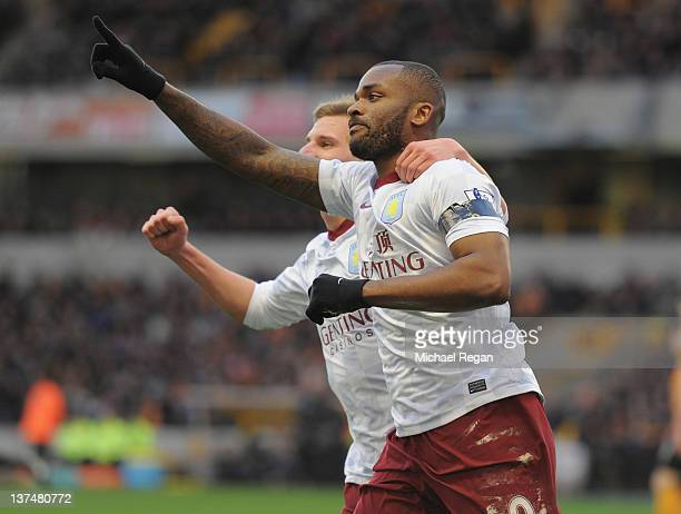 Darren Bent of Aston Villa celebrates scoring a penalty to make it 10 with team mate Marc Albrighton during the Barclays Premier League match between...