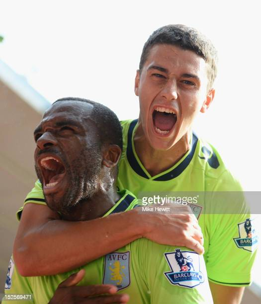 Darren Bent of Aston Villa celebrates with team mate Matthew Lowton after scoring during the Barclays Premier League match between Southampton and...