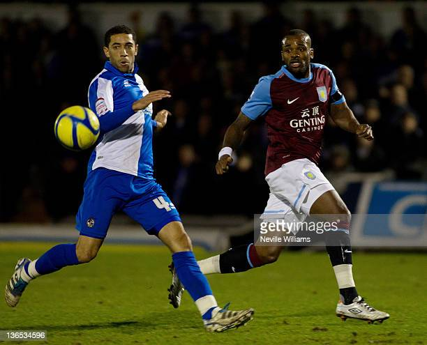 Darren Bent of Aston Villa is challenged by Danny Woodwards of Bristol Rovers during the FA Cup Third Round match between Bristol Rovers and Aston...