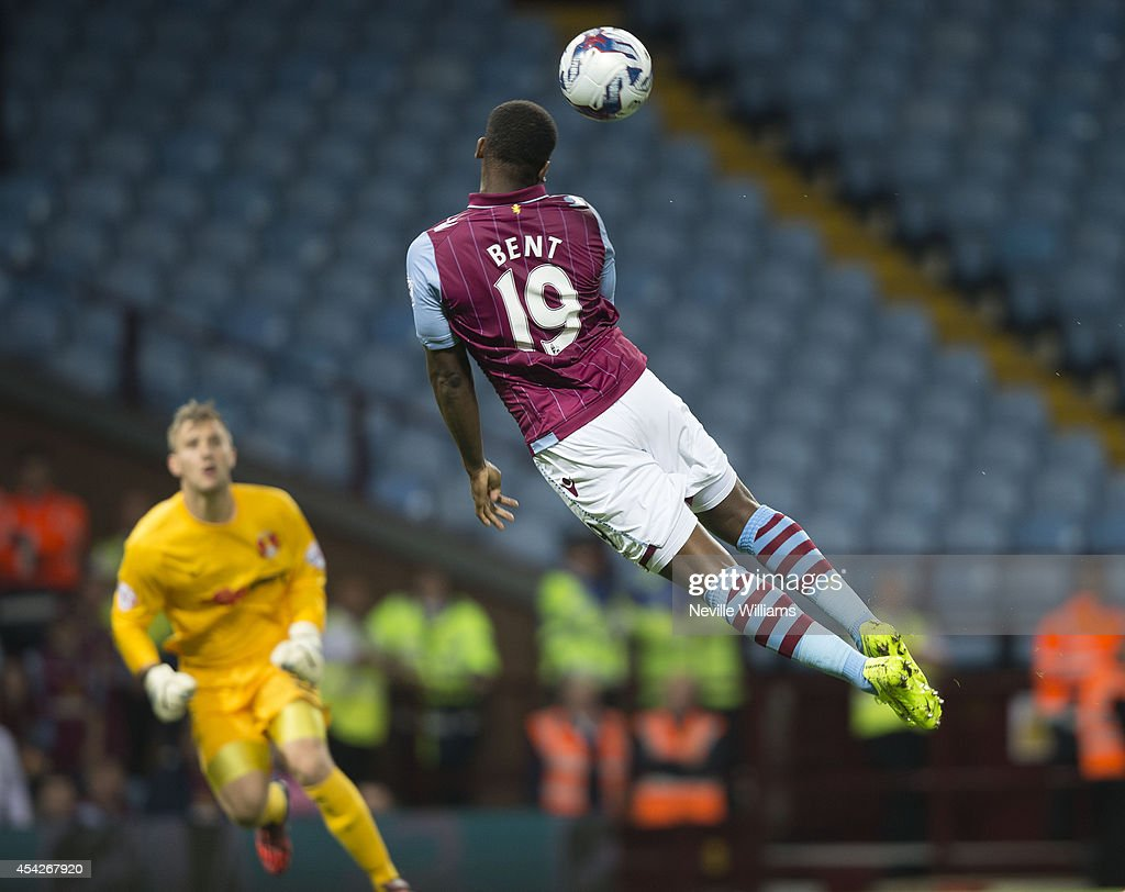 Darren Bent of Aston Villa jumps during the Capital One Cup second round match between Aston Villa and Leyton Orient at Villa Park on August 27, 2014 in Birmingham, England.