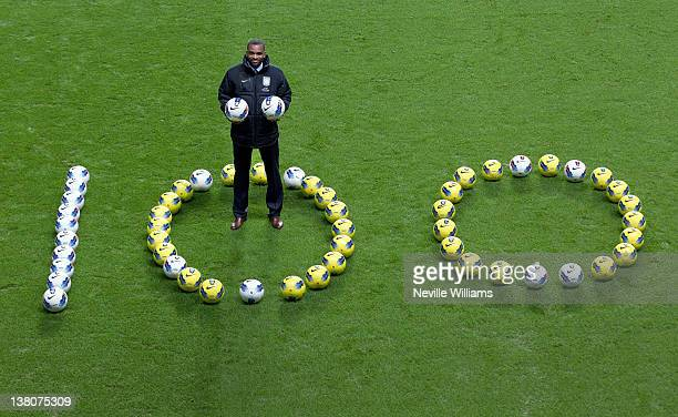Darren Bent of Aston Villa poses for a photo to celebrate scoring his 100th career Barclays Premier League goal during the game between Aston Villa...